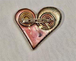 "$20  Detail: Back view. Heart shaped pin.  2"" x 2"""