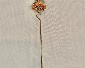 "$25 Stick pin. 5""L"