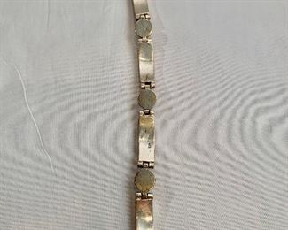 """$115 Detail; Back view. Mexican sterling silver with coral colored stone bracelet. 8""""L"""