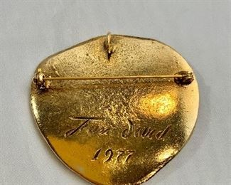 """Detail; Back view. Jean David 1977, signed, gold tone with red stone pendant/brooch. 2.25""""D"""