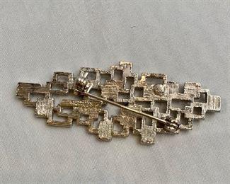 """Detail; Back view. Silver tone pin.  2.5""""L"""