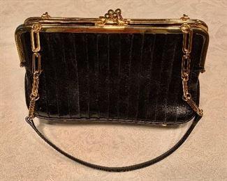 "$50 DKNY black leather three compartment handbag.  9"" x 5"""