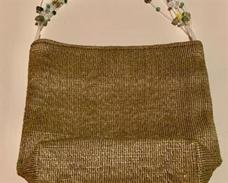 $20 Hand made fabric evening bag with a beaded handle.