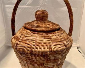 "Hand woven basket - $75; Approx 15"" high"