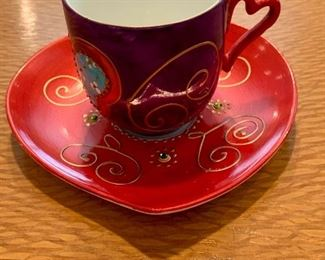 $30  - Hand painted and embellished demitasse cup and saucer; signed.
