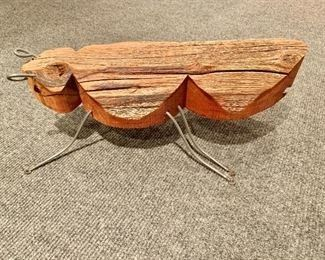 "$75 Wood/metal bug #1; approx. 18""L x  7""W x 6""H"
