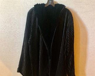 $40 - Reversible velvet jacket. Estimated size XL.