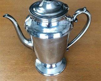 "$40 Silver plate coffee pot. 10""H x 9""W"