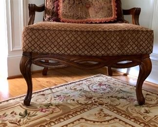 Wood front details of matching upholstered chairs