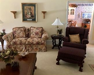 Floral loveseat, nice side tables and straight back chair and ottoman
