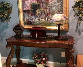 Glass top console table, great art work throughout the house.