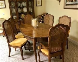 French Provincial dining room table with 6 cane back chairs, Last supper picture and Provincial china cabinet