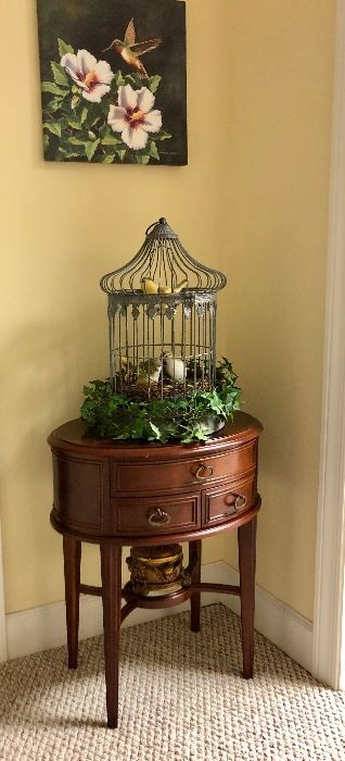 Nice oval side table, bird cage, hummingbird picture