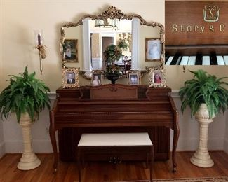Story & Clark piano, urns with ferns, large gold mirror