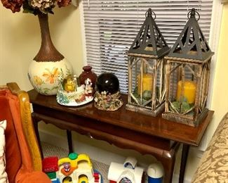 Cherry console table, 2 wooden lanterns with candles, tall painted vase, Little Tikes and Fisher Price toys