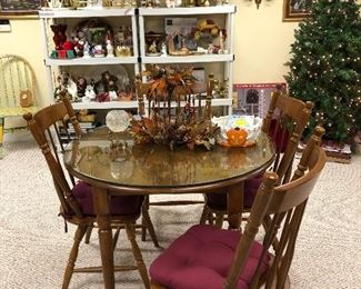 Round wood table with glass top and 4 matching chairs, fall decor, 5ft Christmas tree and lots of great items on the shelves!