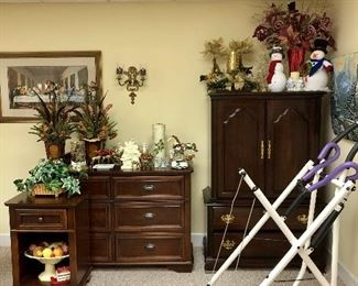 Dresser with mirror behind it, side table, silk flower arrangements, snowman, Christmas decor and more