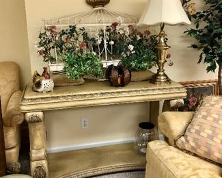 Large console table, metal wall art, one of two brass lamps