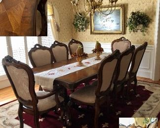 Dining table with 8 upholstered chairs