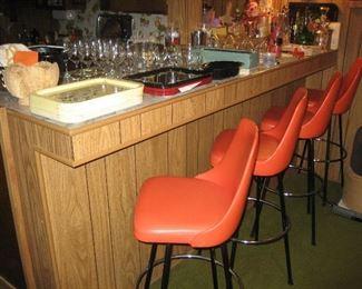 Mid-century 4 orange 60's bar stools