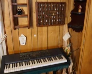 keyboard with stand and bench (not shown), thimble collection, shelves,