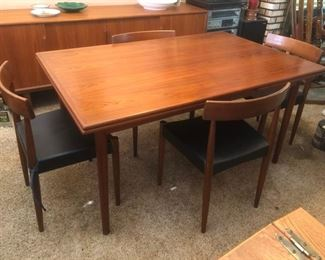 Danish mid-century modern dining table (with pull out leaf!) and 4 chairs...