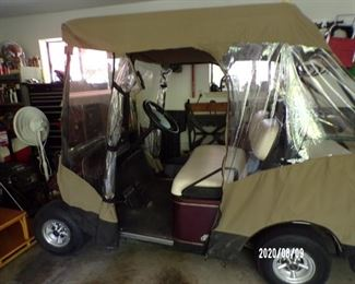 ezy go golf cart w/added seats on back and cover
