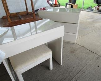 Lane Furniture include this vanity and bench, and 2 three drawer chests Queen size bed and other pieces. The bedspread, mattress pad, and bed skirt  are in the sale also.