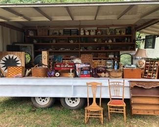 Vending trailer full of items priced at $25 each (5 for $100)