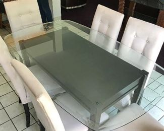 Glass top dining room table with six matching chairs