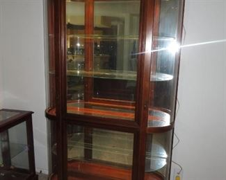 Beautiful lighted curio cabinet MUST SEE!