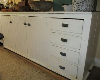 3 doors & 4 drawers it has the same 3 doors & 4 drawers on the on the back side.  Would make a great island.