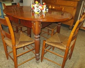 drop leaf table with 4 leaves, set of 8 rush seat chairs