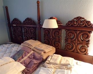 wood headboard on king bed w/nice mattresses, will separate