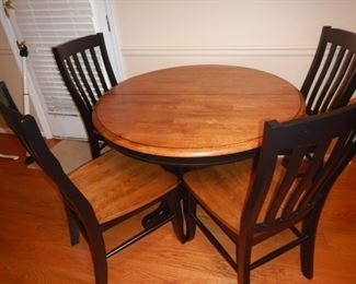 Round dining set with four chairs