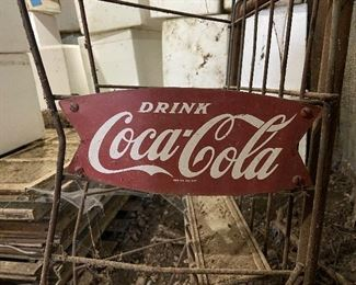 Fish tail Coca Cola Sign On Rusted Drink Cart
