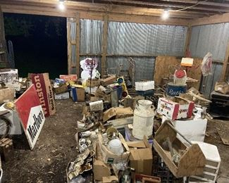 Vintage antiques piled in barn! Still digging and cleaning up signs and old treasures.