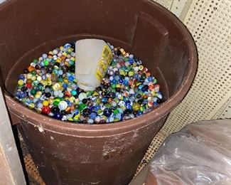 barrels full of old vintage marbles