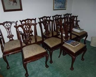 Set of 10 antique Chinese Chippendale dining chairs.  Rare to find 10 antique dining chairs in such good condition.   They were purchased in New York many years ago.   These chairs are heavy and two of the chairs are arm chairs.