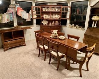 Mid Century Modern, Made by STERLINGWORTH CORP., Jamestown, NY, with Double-Drop-Leaf long Table & 6 Chairs, Fold-Out- Buffet with Silverware Drawer, and a 2-Piece China Cabinet, and a large set of FRANCISCAN dishes