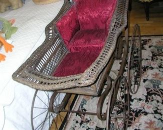 "Item 20: Antique Victorian Wicker Baby Carriage (Pram) - Very Good to Excellent Condition, especially for its age - slight damage, but not much - 52"" overall length x 38"" tall x 22"" wide - Wheels are 22"" in diameter Asking Price: $295.00"