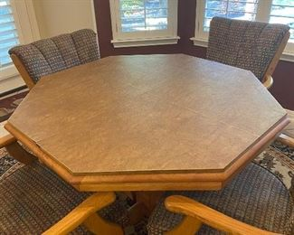 dinette with 4 rolling chairs, and extra leaf and table pads included