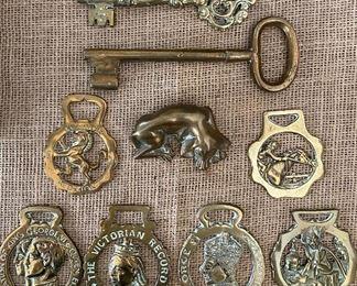 English brass horse bridle medallions, bronze dog and large ornate brass keys