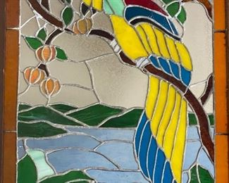 Stained glass window of a parrot