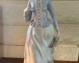 Porcelain figurine of woman holding flowers by NADL