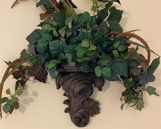 Wall pocket with faux greenery