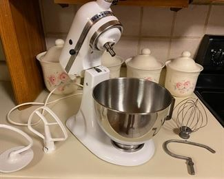 White KitchenAid stand mixer with attachments