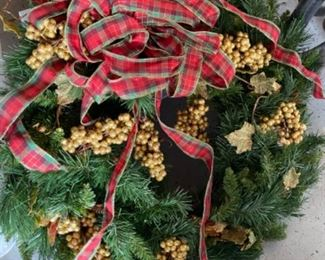 Christmas wreath with gold berries and tartan plaid ribbon