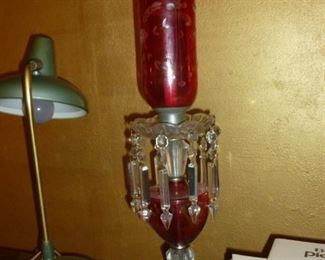 One of a pair of antique cranberry lusters