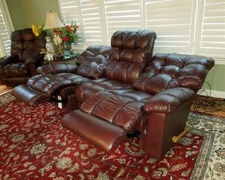 1 brown leather reclining sofa and 1 brown leather reclining chair, both by LazBoy